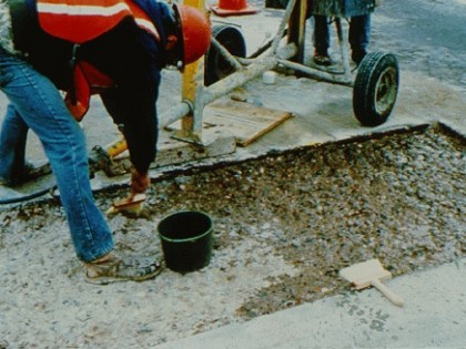 Preparation of a shallow defect on a highway bridge deck