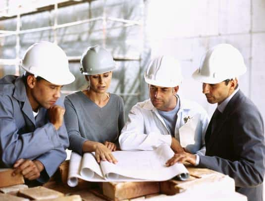 Engineers Reading Civil Engineering Drawings