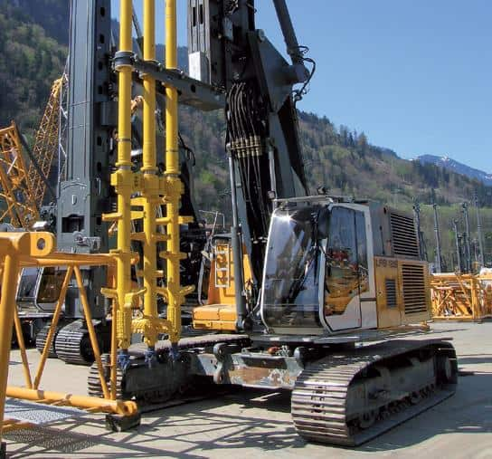 Deep soil mixing rig with triple mixing tool