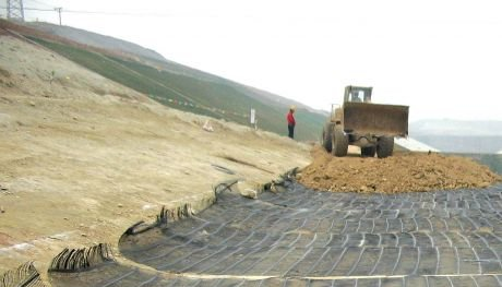 Placing of soil over the reinforcement material