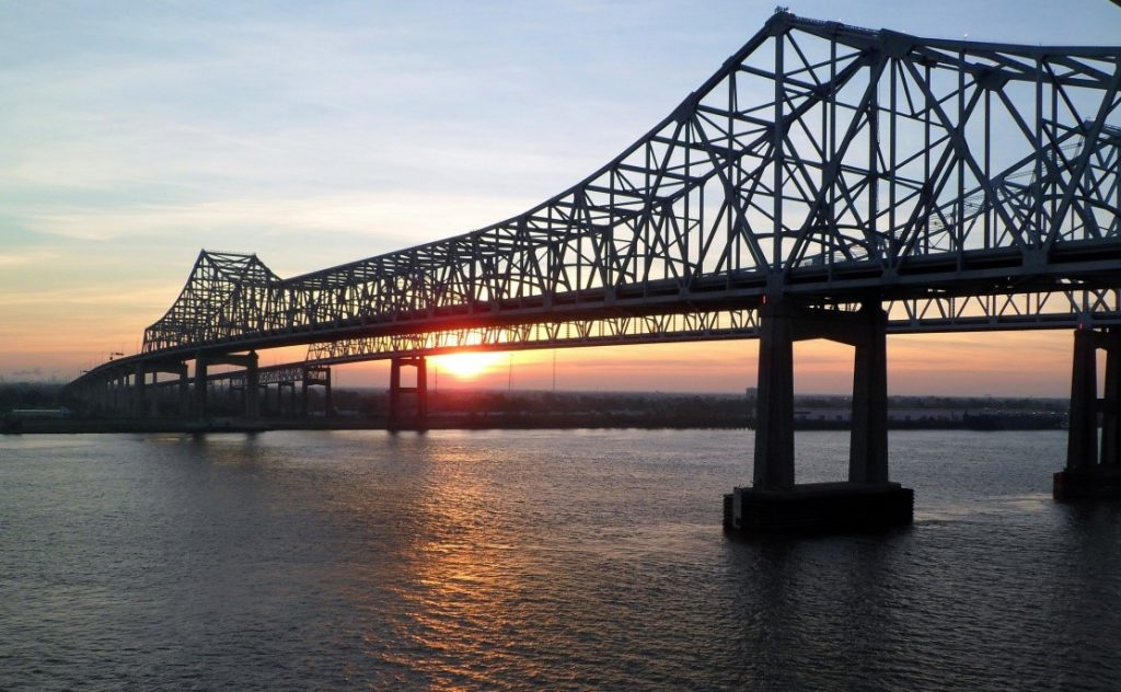 Truss bridge across Mississippi river, New Orleans (GoodFree Photos)