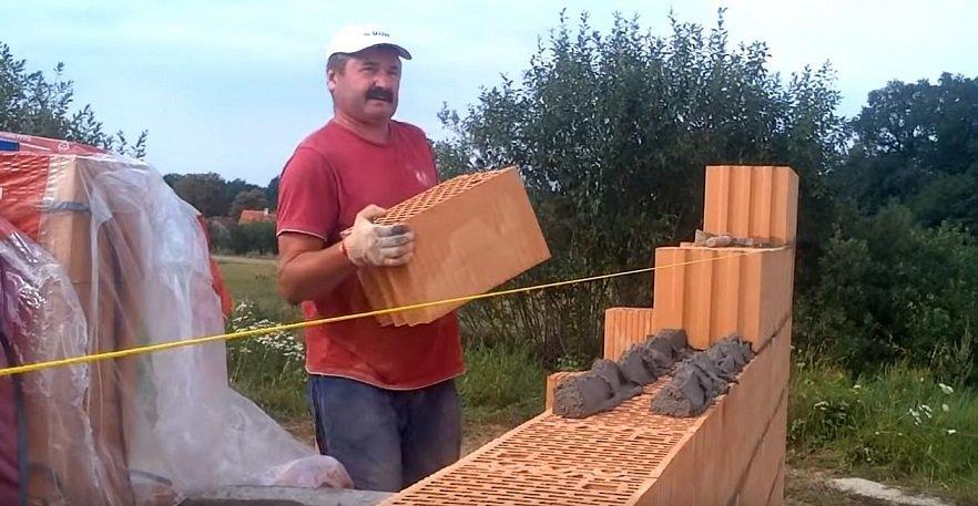 Brick Mason Placing Brick Layers over mortar